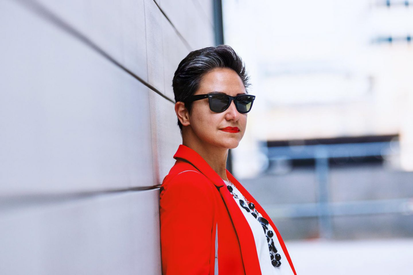 Channeling Hillary Clinton meets Miami Vice in a power red blazer